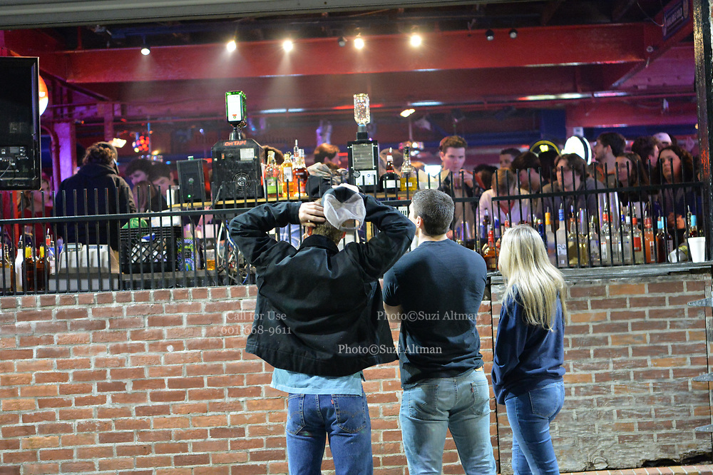 3/5/21 Oxford MS. Oxford, Mississippi, USA: March 5, 2021, Students of The University of Mississippi, aka, Ole Miss, party and enjoy a night out on the first Friday night after Governor Tate Reeves lifted the state wide mask mandate. The bars in downtown Oxford were packed with students shoulder to shoulder drinking and partying. Dr Fauci has stated that Mississippi and Texas residents should continue to abide by public health measures, including wearing masks and social distancing, even as Republican Governors have lifted all Covid-19 restrictions in Texas and Mississippi. Photo© Suzi Altman DailyMail.com