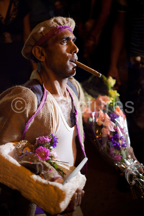 The pilgrimage of San Lazaro in December is the largest religious event in Cuba when thousands of people make their way to El Rincon church on the outskirts of Havana. Santeria is a syncretic religion practiced in Cuba, it is a mixture of Yoruba tribal practices brought from Nigeria during Colonial times, and traditional Catholic beliefs. During this time, the slaves used the images of saints to cover up their worship of the Orishas (spirits)