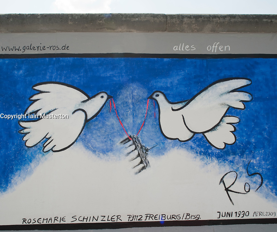 Painting of two doves holding Brandenburg Gate on newly repainted Berlin Wall at East Side Gallery Berlin April 2009