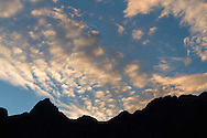 Blanshard Peak and Evans Peak silhouetted against the sky at sunset.  Photographed along the Lower Falls Trail in Golden Ears Provincial Park in Maple Ridge, British Columbia, Canada