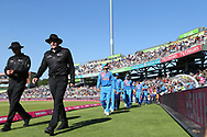 Umpires lead out the India team during the International T20 match between England and India at Old Trafford, Manchester, England on 3 July 2018. Picture by George Franks.