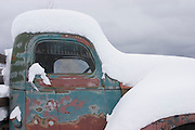 Closeup of old truck with snowy coat