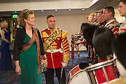 THE COUNTESS OF KINNOUL; DRUM MAJOR ROBERT MCCUTCHEON, PIPES AND DRUMS 1ST BATTALION SCOTS GUARDS, The Royal Caledonian Ball 2016. Grosvenor House. Park Lane, London. 29 April 2016