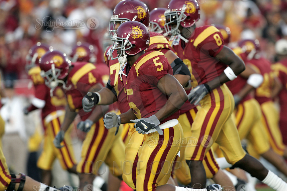 January 4, 2006: #5 Reggie Bush of the USC Trojans runs onto the field with teammates before a game versus the Texas Longhorns in the Rose Bowl Game and BCS National Championship at the Rose Bowl in Pasadena, CA. UT beat Southern California 41-38 for the National Championship.