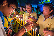 05 DECEMBER 2012 - BANGKOK, THAILAND: People light candles for the King during the public ceremony to celebrate the birthday of Bhumibol Adulyadej, the King of Thailand, on Sanam Luang, a vast public space in front of the Grand Palace in Bangkok Wednesday night. The King celebrated his 85th birthday Wednesday and hundreds of thousands of Thais attended the day long celebration around the Grand Palace and the Royal Plaza, north of the Palace. The Thai monarch is revered by most Thais as unifying force in Thailand's society, which is not yet recovered from the political violence of 2010.      PHOTO BY JACK KURTZ