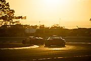 March 20, 2021. IMSA Weathertech Mobil 1 12 hours of Sebring: #16 Wright Motorsports, Porsche 911 GT3R, Trent Hindman, Patrick Long, Jan Heylen, #1 Paul Miller Racing Lamborghini Huracan GT3, GTD: Bryan Sellers, Madison Snow, Corey Lewis