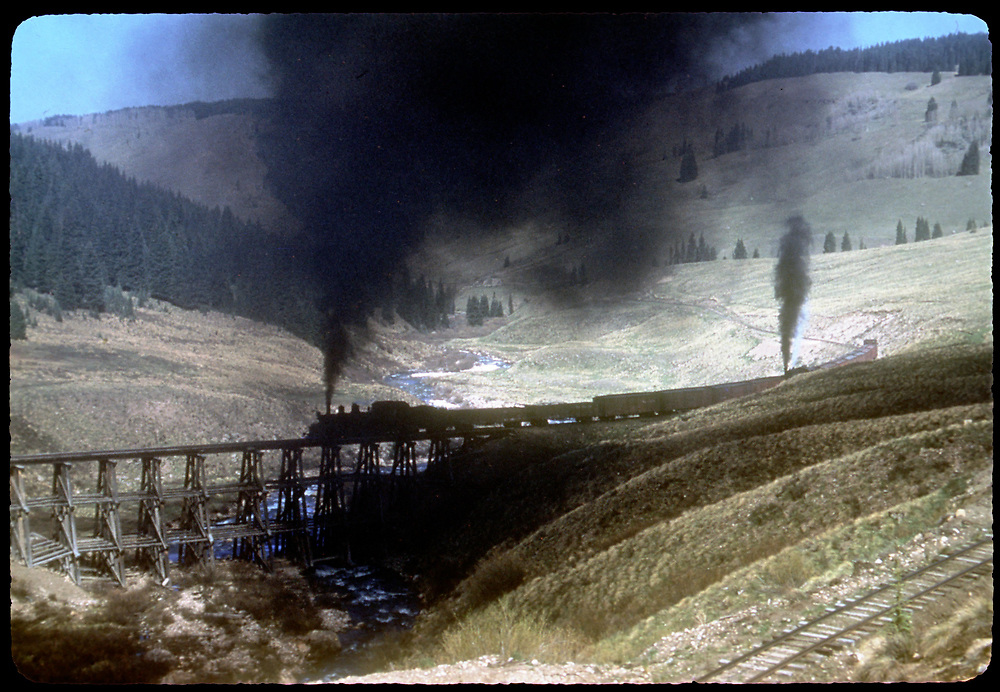 RGS #455 with northbound freight and mid-train helper #461 crossing Lower Gallagher Trestle as viewed from just above Upper Gallagher Trestle.<br /> RGS  Gallagher, CO  Taken by Kindig, Richard H. - 6/7/1951<br /> Thanks to Don Bergman for additional information.