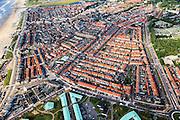 Nederland, Zuid-Holland, Katwijk, 15-07-2012; Overzichtsfoto Katwijk met links de Boulevard. De huizen aan de boulevard zijn gebouwd in de periode direct na de oorlog, de wederopbouw. Het gebied direct ten oosten van de Boulevard, vanaf de witte vuurtoren (Vuurbaken) tot aan de Oude Rijn is namelijk tijdens de Tweede Wereldoorlog gesloopt ivm aanleg van de Atlantikwall. De Andreaskerk (ook Oude Kerk of Witte Kerk), lag midden in deze sloopzone maar bleef gespaard..Post-war reconstruction houses next to the esplanade. During the Second World War, the strip immediately next to the boulevard was demolished in order build the Atlantic wall..luchtfoto (toeslag), aerial photo (additional fee required).foto/photo Siebe Swart
