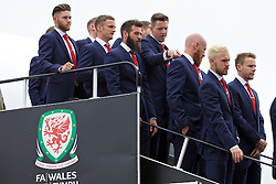 CARDIFF, WALES - Saturday, June 4, 2016: Owain Fon Williams adjusts the collar of James Collins' suit as the team pose for a photograph on the steps of the plane at Cardiff Airport as the squad head to Sweden for their last friendly before the UEFA Euro 2016 in France. (Pic by Paul Greenwood/Propaganda)