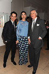 Left to right, FRANCOIS LE TROQUER MD Cartier UK, CAROLINE ISSA and ARNAUD BAMBERGER Executive Chairman Cartier UK at a reception to present the new Cartier Tank Watch Collection held at The Orangery, Kensington Palace Gardens, London W8 on 19th April 2012.