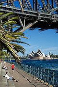Sydney Harbour Bridge viewed from Milsons Point, with Sydney Opera House in background. Sydney, Australia