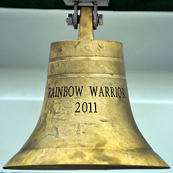 © Licensed to London News Pictures. 08/11/2011. London, UK. The bell at the bow of the Greenpeace flagship, Rainbow Warrior in South Quay in London's Docklands today 8th November 2011, after making her maiden voyage from Amsterdam. It is the first Greenpeace ship to have been specifically built, the previous two being refits. Photo credit : Stephen Simpson/LNP