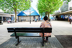 A woman sitting on a bench on her own. Basildon Essex