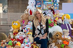 Denise van Outen attends a photocall to launch the annual Argos Toy Exchange at Coq d'Argent, London, United Kingdom. Tuesday, 15th October 2013. Picture by i-Images