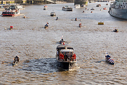 © Licensed to London News Pictures. 11/11/2018. London, UK.  A flotilla of boats including the Royal barge, QRB Gloriana, the Havengore and traditional boats travel up the River Thames towards the Houses of Parliament in Westminster for a remembrance service, led by the Havengore, as part of Armistice Day centenary events taking place in central London. Big Ben will strike at 11am to mark the start of the two minutes silence and the Havengore will sound her horn to signify the end of the two minutes silence in central London.  Photo credit: Vickie Flores/LNP