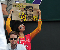Tennis - 2017 Wimbledon Championships - Week Two, Wednesday [Day Nine]<br /> <br /> Men's Singles, Quarter Final match<br /> <br /> Roger Federer (SUI) vs. Milos Roanic (CAN)<br /> <br /> Roger Federer fan with her Perfect banner for Roger on  Centre Court <br /> <br /> COLORSPORT/ANDREW COWIE