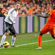NLD/Amsterdam/20121114 - Vriendschappelijk duel Nederland - Duitsland, Benedikt Howedes in duel met Bruno Martins Indi