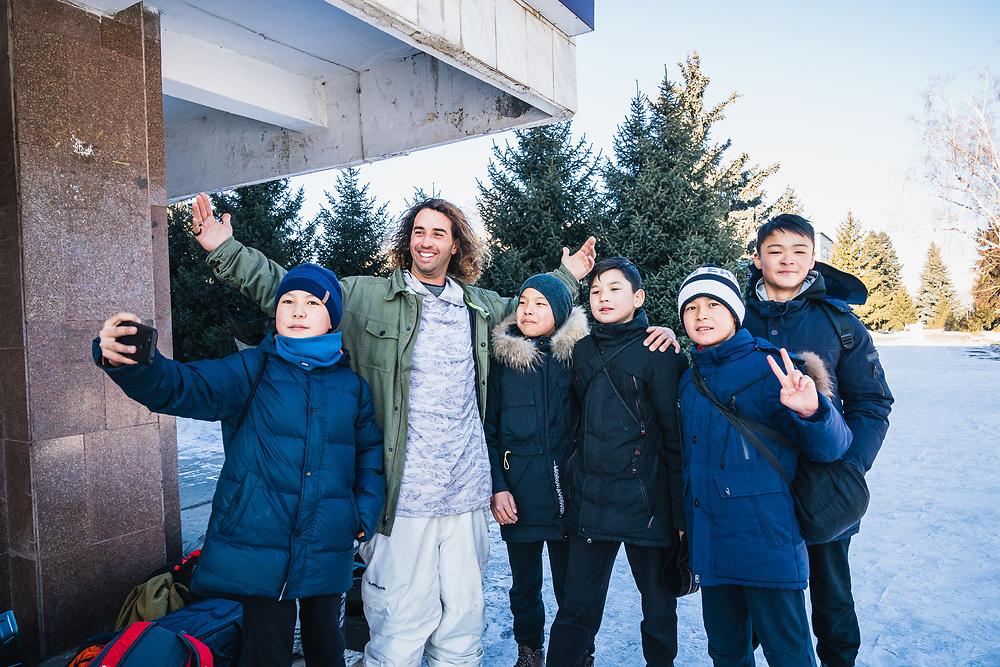 Ahmet Dadali greets curious students on the streets of Karakol, KG..