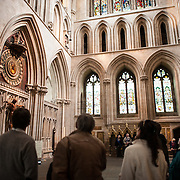 Tourists watch the famous clock of Wells Cathedral in Wells, Somerset, United Kingdom. Some of the building dates back to the 10th Century.