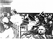 British suffragette movement.  Mrs Pankhurst (right) Mrs Flora Drummond and Cristabel Pankhurst in the dock accused of conspiracy, 14 October 1908 during the struggle for votes for women. Photograph.