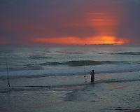 Surf Fishing at Dawn. Playalinda Beach, Canaveral National Seashore in Florida. Image taken with a Nikon D700 camera and 28-3 00 mm VRlens (ISO 500, 85 mm, f/5.6, 1/320 sec).