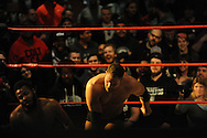"""Ryan Galeone knocks down Jonathan Gresham during a bout at the Beyond Wrestling Organization's """"Dream Left Behind"""" event, held at the Center for Arts at the Armory in Somerville, Sunday, Jan. 31, 2016."""