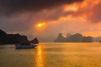 Sunset at Halong Bay, North Vietnam. The bay features 3,000  limestone and dolomite karsts and islets in various shapes and sizes sprinkled over 1,500 square kilometers. It offers a wonderland of karst topography. It is a UNESCO World Heritage Site.