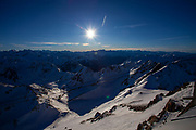 View from Pic du Midi de Bigorre, a 2877m mountain in the French Pyrenees, home to an astronomical observatory and visitors centre. The observatory is acccessible from the village of La Mongie by cablecar. Tourists often visit in time for the spectacular sunset across the mountains.
