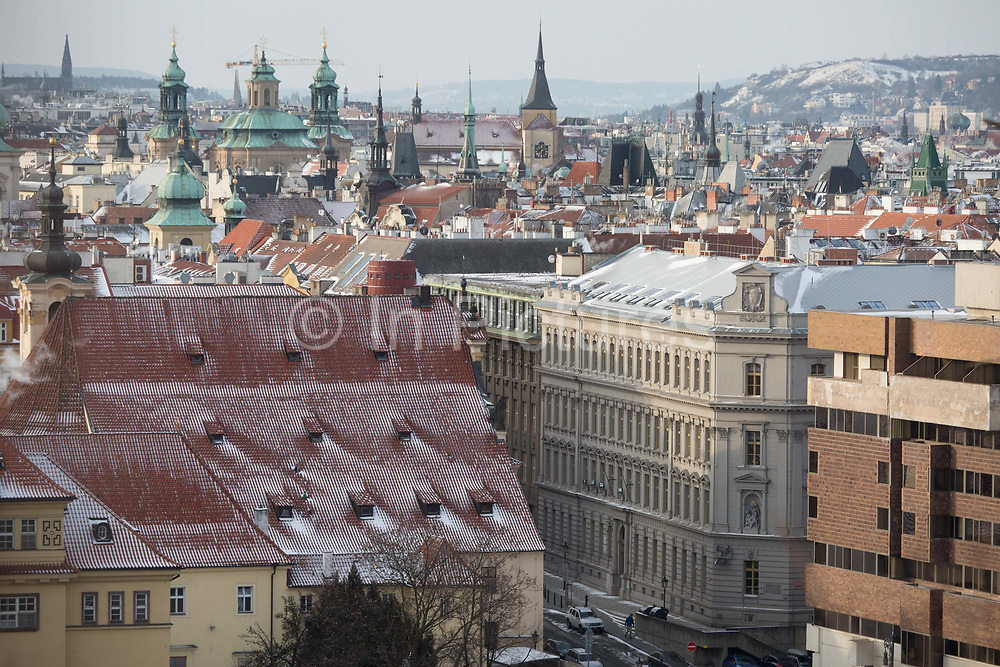 Views from Letna Park over rooftops and tall church steeples in Stare Mesto, the citys old quarter - on 18th March, 2018, in Prague, the Czech Republic. Like Rome, Prague is built on seven hills.