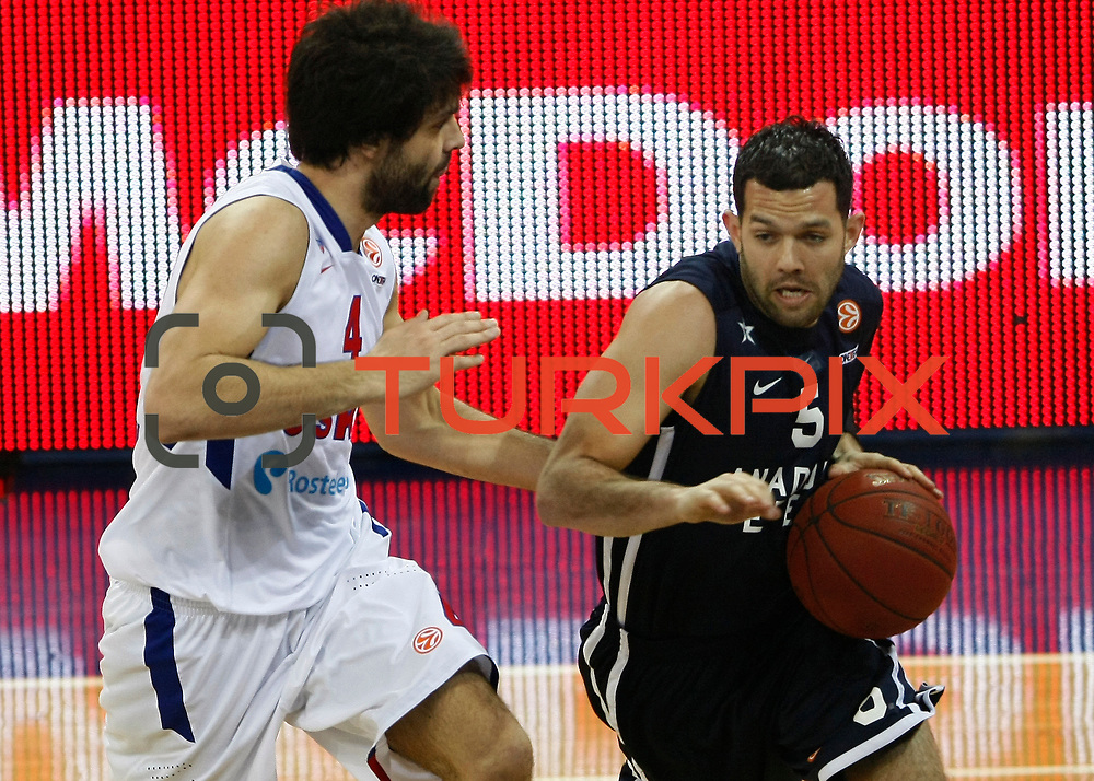 Anadolu Efes's Jordan Farmar (R) and CSKA Moscow's Milos Teodosic (L) during their Euroleague Top 16 game 8 basketball match Anadolu Efes between CSKA Moscow at the Abdi Ipekci Arena in Istanbul at Turkey on Friday, February, 22, 2013. Photo by TURKPIX