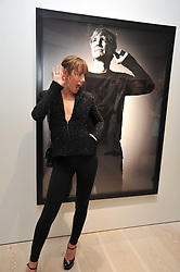 TARA PALMER-TOMKINSON at an exhibition of photographic portraits by Bryan Adams entitled 'Hear The World' at The Saatchi Gallery, King's Road, London on 21st July 2009.