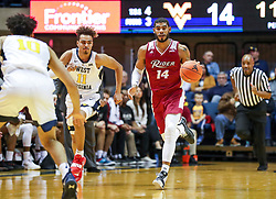 Nov 28, 2018; Morgantown, WV, USA; Rider Broncs guard Dimencio Vaughn (14) dribbles the ball during the first half against the West Virginia Mountaineers at WVU Coliseum. Mandatory Credit: Ben Queen-USA TODAY Sports