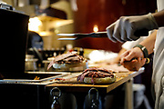 SHOT 10/24/17 10:48:59 AM - Carving roast beef at Schwabl's Roast Beef in West Seneca, N.Y. Schwabl's is a landmark spot for signature beef on weck and rib-sticking German-American fare in an old-fashioned setting. Buffalo, N.Y. is the second most populous city in the state of New York and is located in Western New York on the eastern shores of Lake Erie and at the head of the Niagara River. By 1900, Buffalo was the 8th largest city in the country, and went on to become a major railroad hub, the largest grain-milling center in the country and the home of the largest steel-making operation in the world. The latter part of the 20th Century saw a reversal of fortunes: by the year 1990 the city had fallen back below its 1900 population levels. (Photo by Marc Piscotty / © 2017)