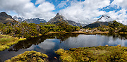 Key Summit Alpine Walk, along the Routeburn Track in Fiordland National Park, near Te Anau, Southland region, South Island of New Zealand. In 1990, UNESCO honored Te Wahipounamu - South West New Zealand as a World Heritage Area. This image was stitched from multiple overlapping photos.