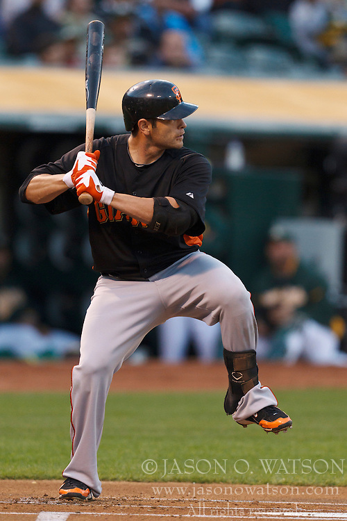 March 29, 2011; Oakland, CA, USA;  San Francisco Giants second baseman Freddy Sanchez (21) at bat against the Oakland Athletics during the first inning at Oakland-Alameda County Coliseum.  San Francisco defeated Oakland 4-1.