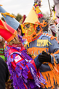 Revelers dance for food during the Faquetigue Courir de Mardi Gras chicken run on Fat Tuesday February 17, 2015 in Eunice, Louisiana. The traditional Cajun Mardi Gras involves costumed revelers competing to catch a live chicken as they move from house to house throughout the rural community.