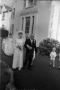 """16/09/1967<br /> 09/16/1967<br /> 16 September 1967<br /> Wedding of Mr Francis W. Moloney, 28 The Stiles Road, Clontarf and Ms Antoinette O'Carroll, """"Melrose"""", Leinster Road, Rathmines at Our Lady of Refuge Church, Rathmines, with reception in Colamore Hotel, Coliemore Road, Dalkey. Image shows the bride leaving home before  the ceremony with her father Mr Dudley O'Carroll."""