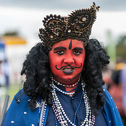© Licensed to London News Pictures. 05/09/2015. Watford, UK. Local schoolboy, Hrithik, dresses up for the day as Kans (Krishna's enemy) at the biggest Janmashtami festival outside of India at the Bhaktivedanta Manor Hare Krishna Temple in Watford, Hertfordshire.  The event celebrates the birth of Lord Krishna and the festival  includes music, dance, food, dramas and more. Photo credit : Stephen Chung/LNP