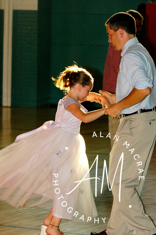 Emily Deducca, 7, mixes it up with her dad Ron during the annual father-daughter dance at the Laconia Community Center on Saturday, June 25, 2005.  (Alan MacRae/for the Citizen)