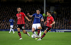 """Everton's Leighton Baines (centre) battles for the ball with Southampton's Cedric Soares (right) and Southampton's Manolo Gabbiadini (left) during the Carabao Cup, third round match at Goodison Park, Liverpool. PRESS ASSOCIATION Photo. Picture date:  Tuesday October 2, 2018. See PA story SOCCER Everton. Photo credit should read: Peter Byrne/PA Wire. RESTRICTIONS: EDITORIAL USE ONLY No use with unauthorised audio, video, data, fixture lists, club/league logos or """"live"""" services. Online in-match use limited to 120 images, no video emulation. No use in betting, games or single club/league/player publications"""