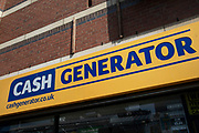 Sign for the buy and sell brand Cash Generator in Birmingham, United Kingdom.