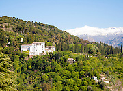 Snow capped peaks of the Sierra Nevada mountains and the Alhambra  Generalife summer palace and gardens, Granada, Spain