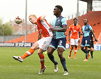 Blackpool's Mark Cullen battles with Wycombe Wanderers' Anthony Stewart<br /> <br /> Photographer Stephen White/CameraSport<br /> <br /> Football - The EFL Sky Bet League Two - Blackpool v Wycombe Wanderers - Saturday 20 August 2016 - Bloomfield Road - Blackpool<br /> <br /> World Copyright © 2016 CameraSport. All rights reserved. 43 Linden Ave. Countesthorpe. Leicester. England. LE8 5PG - Tel: +44 (0) 116 277 4147 - admin@camerasport.com - www.camerasport.com