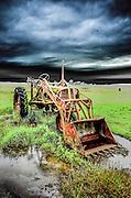Antique Farmall Super C tractor resting in Skagit Valley Washington field.