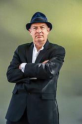 """Pictured: Martin Rowson<br /><br />Martin Rowson is a British editorial cartoonist and writer. His genre is political satire and his style is scathing and graphic. He characterizes his work as """"visual journalism"""". His cartoons appear frequently in The Guardian and the Daily Mirror<br /><br />Ger Harley 