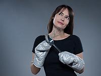 one caucasian woman thinking holding kitchen utensils isolated studio on grey background