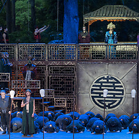 Romanian soprano Cristina Pasaroiu (top C) and Argentine opera legend José Cura (bottom L) in the lead and title roles perform during the dress rehearsal of Giacomo Puccini: Turandot at the Margaret Island Open-Air Stage in Budapest, Hungary on June 5, 2019. ATTILA VOLGYI