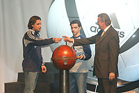 LISBOA-29 NOVEMBRO 2003:NUNO GOMES, player of S.L.Benfica delivers the key that opens the Adidas Roteiro vault to GERAHARD AIGNER executive director of UEFA 29/11/2003, in the photo from left to rigth GILBERTO MADAIL (President of the EURO 2004),NUNO GOMES (S.L.Benfica), SIMÃO SABROSA (S.L.Benfica) and GERAHARD AIGNER (E.D. UEFA); ADIDAS presents the official ball for the EURO 2004 in FILL auditorium-Lisbon<br />(PHOTO BY: AFCD/NUNO ALEGRIA)