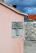Memorial plaque on side of house, Zrnovo village, island of Korcula, Croatia