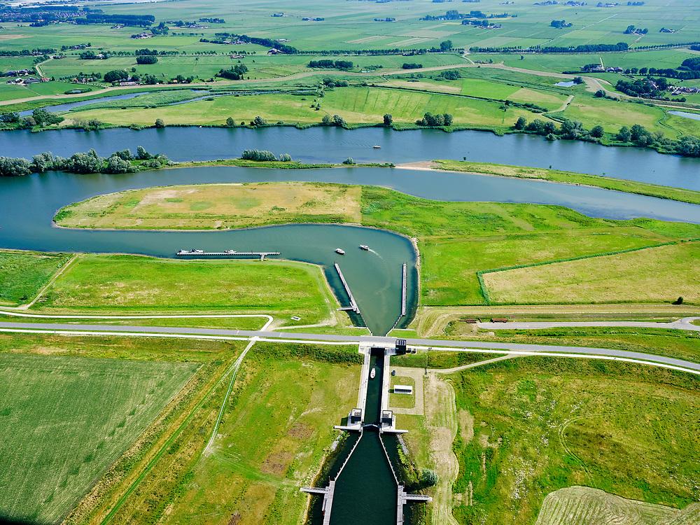 """Nederland, Overijssel, Gemeente Kampen; 21–06-2020; zicht op de IJssel ter hoogte van Wilsum met de Onderdijkse Waard.<br /> Het Reevediep is aangelegd in het kader van het project Ruimte voor de Rivier om bij hoogwater water af te voeren voordat dit het nabij gelegen Kampen bereikt, direct naar het IJsselmeer, de 'bypass Kampen'. Het Reevediepgebied is ook een natuurgebied en vormt een ecologische verbindingszone tussen rivier de IJssel en Drontermeer.<br /> View of river IJssel near Wilsum with the Onderdijkse Waard. Foreground the Scheeresluis, recreational lock and entrance for the pleasure craft of the Reevediep.<br /> The Reevediep has been constructed as part of the Room for the River project, and functions to discharge high waters before reaching the nearby Kampen, directly to the IJsselmeer, the """"bypass Kampen"""". The Reevediep area is also a nature reserve and forms an ecological connecting zone between the river IJssel and Drontermeer.<br /> <br /> luchtfoto (toeslag op standard tarieven);<br /> aerial photo (additional fee required)<br /> copyright © 2020 foto/photo Siebe Swart"""
